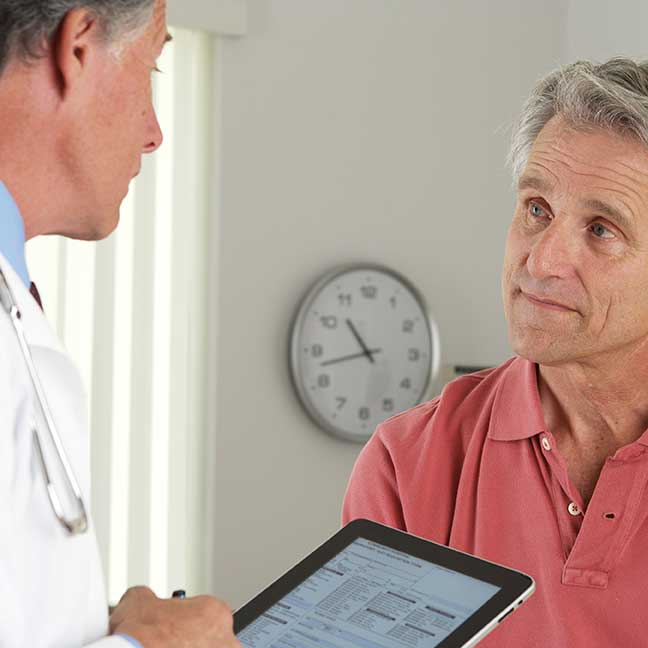 Image of doctor communicating with patient