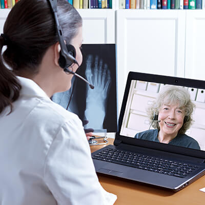 doctor discussing x-ray with patient via telehealth technology